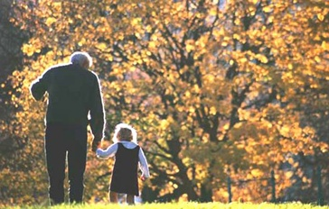 Older man walking with child